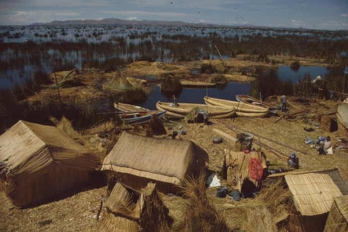 Reed soil, houses and boats, Lake Titicaca, Peru
